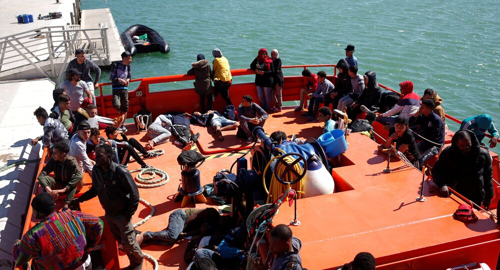 Migrants of a group intercepted aboard dinghies off the coast in the Strait of Gibraltar, are seen on a rescue boat after arriving at the port of Barbate, southern Spain, June 27, 2018