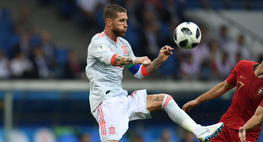 Spain's Sergio Ramos , left, and Portugal's Goncalo Guedes struggle for a ball during the World Cup Group B soccer match between Portugal and Spain at the Fisht stadium in Sochi, Russia, June 15, 2018