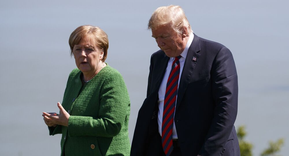 President Donald Trump, right, talks with German Chancellor Angela Merkel after the family photo during the G7 Summit, Friday, June 8, 2018, in Charlevoix, Canada
