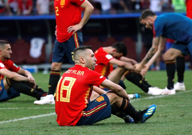 Soccer Football - World Cup - Round of 16 - Spain vs Russia - Luzhniki Stadium, Moscow, Russia - July 1, 2018 Spain's Jordi Alba and team mates look dejected after the match