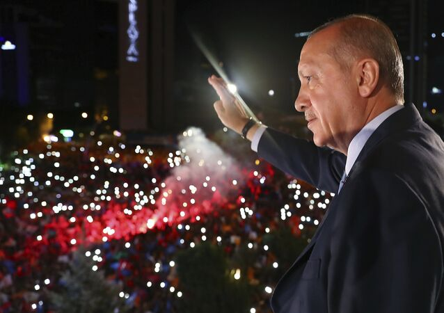 Turkey's President Recep Tayyip Erdogan, waves to supporters of his ruling Justice and Development Party (AKP) in Ankara, Turkey, early Monday, June 25, 2018. Erdogan won Turkey's landmark election Sunday, the country's electoral commission said, ushering in a new system granting the president sweeping new powers which critics say will cement what they call a one-man rule