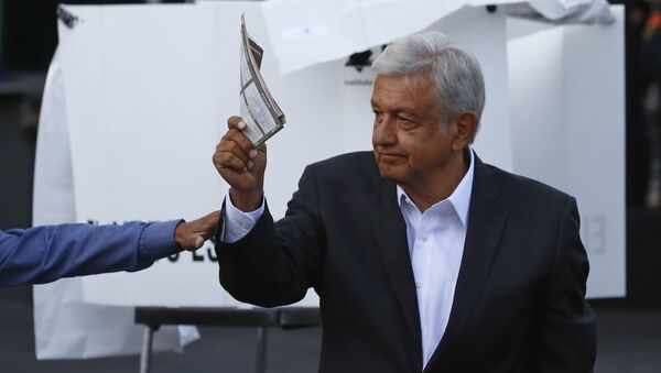 Presidential candidate Andres Manuel Lopez Obrador, of the MORENA party, shows his ballot to the press before casting it during general elections in Mexico City, Sunday, July 1, 2018. Sunday's elections for posts at every level of government are Mexico's largest ever and have become a referendum on corruption, graft and other tricks used to divert taxpayer money to officials' pockets and empty those of the country's poor - Sputnik International