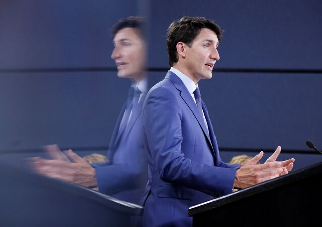 Canada's Prime Minister Justin Trudeau is reflected in a monitor while speaking during a news conference in Ottawa, Ontario, Canada, June 20, 2018