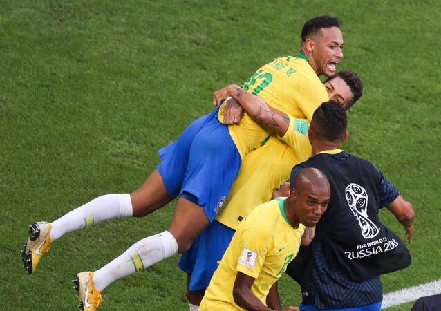 Brazil's Neymar, left, and Brazil's Roberto Firmino celebrate a goal during the World Cup Round of 16 soccer match between Brazil and Mexico at the Samara Arena, in Samara, Russia, July 2, 2018
