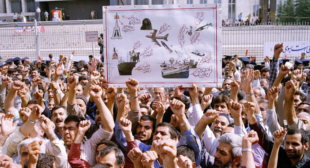 Thousands of Iranians chanting Death to America, participate in a mass funeral for 76 people killed when the USS Vincennes shot down Iran Air Flight 655, in Tehran, Iran, July 7, 1988