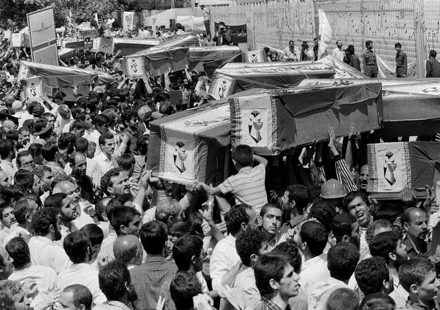 A funeral procession is held for six Pakistani and Indian nationals who were killed aboard Iran Air Flight 655, July 12, 1988, in Iran