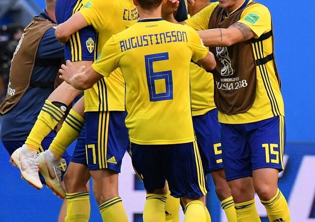 Soccer Football - World Cup - Round of 16 - Sweden vs Switzerland - Saint Petersburg Stadium, Saint Petersburg, Russia - July 3, 2018 Sweden's Oscar Hiljemark and team mates celebrate after the match