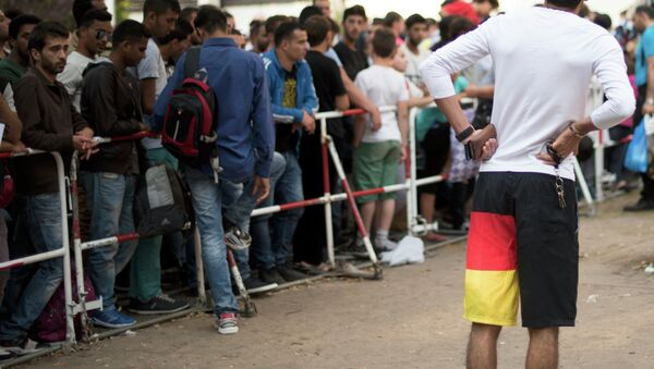 Newly arrived migrants wait in front of the State Office for Health and Social Affairs to apply for asylum in Berlin, Germany August 11, 2015 - Sputnik International