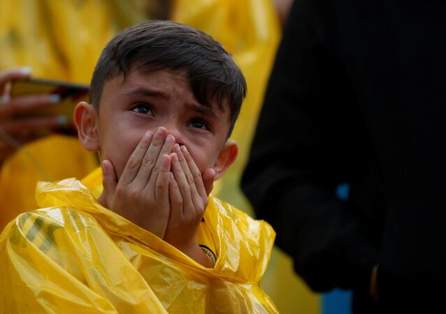A Colombian fan reacts while watching the broadcast of the World Cup Round of 16 soccer match between Colombia and England in Bogota, Colombia July 3, 2018
