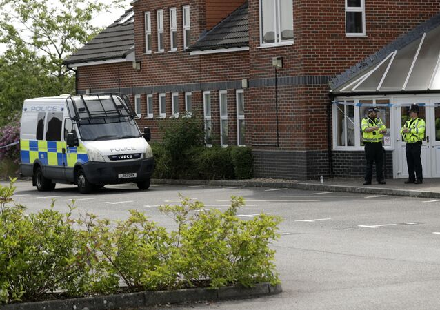 British police officers guard a cordon outside the Amesbury Baptist Centre church in Amesbury, England, Wednesday, July 4, 2018