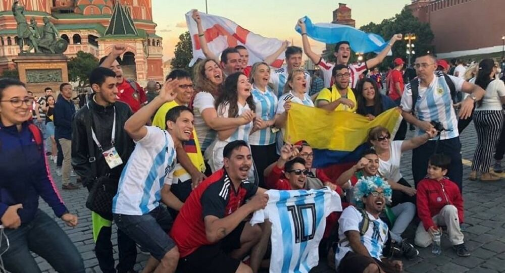 Football fans near the Saint Basil's Cathedral in the Red Square in Moscow
