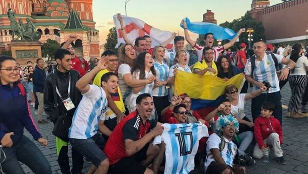Football fans near the Saint Basil's Cathedral in the Red Square in Moscow - Sputnik International