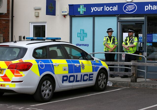 Police officers guard outside a branch of Boots pharmacy, which has been cordoned off after two people were hospitalised and police declared a 'major incident', in Amesbury, Wiltshire, Britain, July 4, 2018