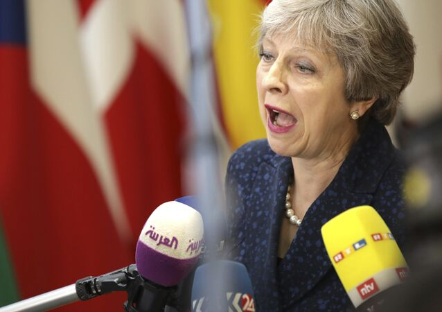 British Prime Minister Theresa May speaks with the media as she arrives for an EU summit at the Europa building in Brussels, Thursday, June 28, 2018.