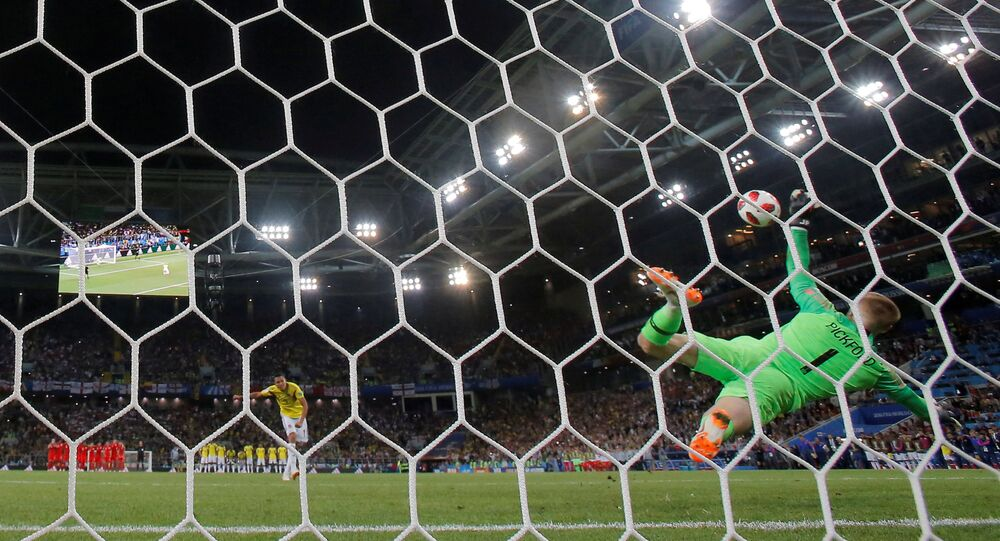 Soccer Football - World Cup - Round of 16 - Colombia vs England - Spartak Stadium, Moscow, Russia - July 3, 2018 England's Jordan Pickford saves Colombia's Carlos Bacca penalty during the shootout