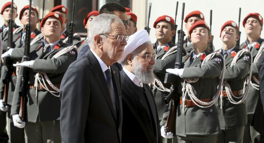 Austrian President Alexander Van Der Bellen, left, and Iranian President Hassan Rouhani attend a military welcome ceremony as part of a meeting in Vienna, Austria, Wednesday, July 4, 2018