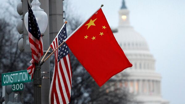 FILE PHOTO: The People's Republic of China flag and the U.S. Stars and Stripes fly on a lamp post along Pennsylvania Avenue near the U.S. Capitol - Sputnik International