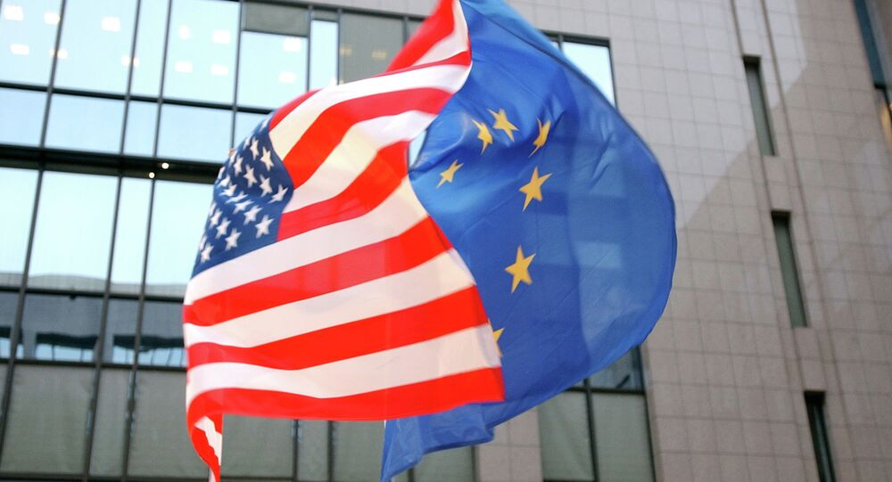 The US and EU flags, left and right, fly side by side at the European Council building in Brussels
