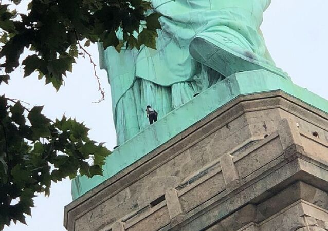 A protester is seen on the Statue of Liberty in New York, New York, U.S., July 4, 2018 in this picture obtained from social media