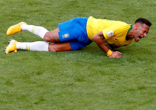 FILE PHOTO: World Cup - Round of 16 - Brazil vs Mexico - Samara Arena, Samara, Russia - July 2, 2018 Brazil's Neymar lies on the pitch after sustaining an injury