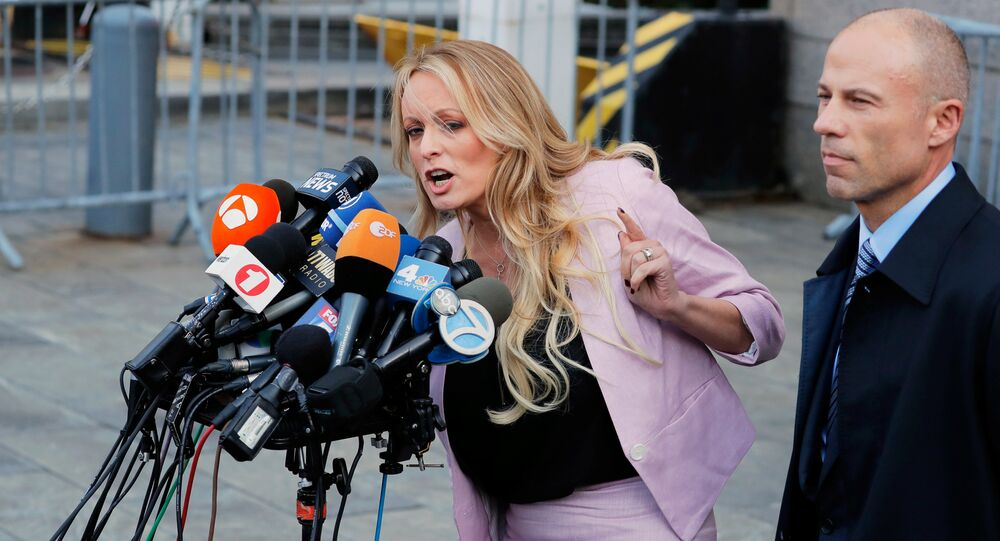 FILE PHOTO: Adult film actress Stephanie Clifford, also known as Stormy Daniels, speaks to media along with lawyer Michael Avenatti (R) outside federal court in the Manhattan borough of New York City, New York, U.S., April 16, 2018