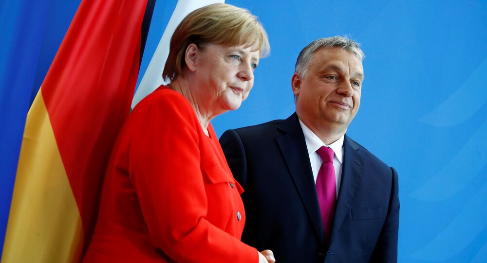 German Chancellor Angela Merkel and Hungarian Prime Minister Viktor Orban shake hands after addressing the media in Berlin, Germany, July 5, 2018