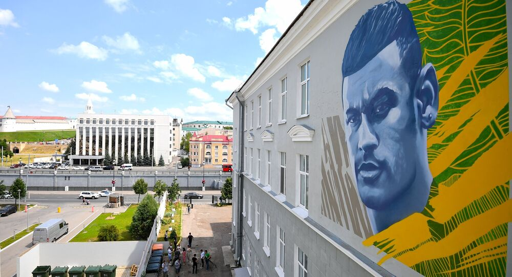 A graffiti depicting famous Brazil's soccer player Neymar decorates a wall of the building in Kazan, Russia, July 5, 2018.