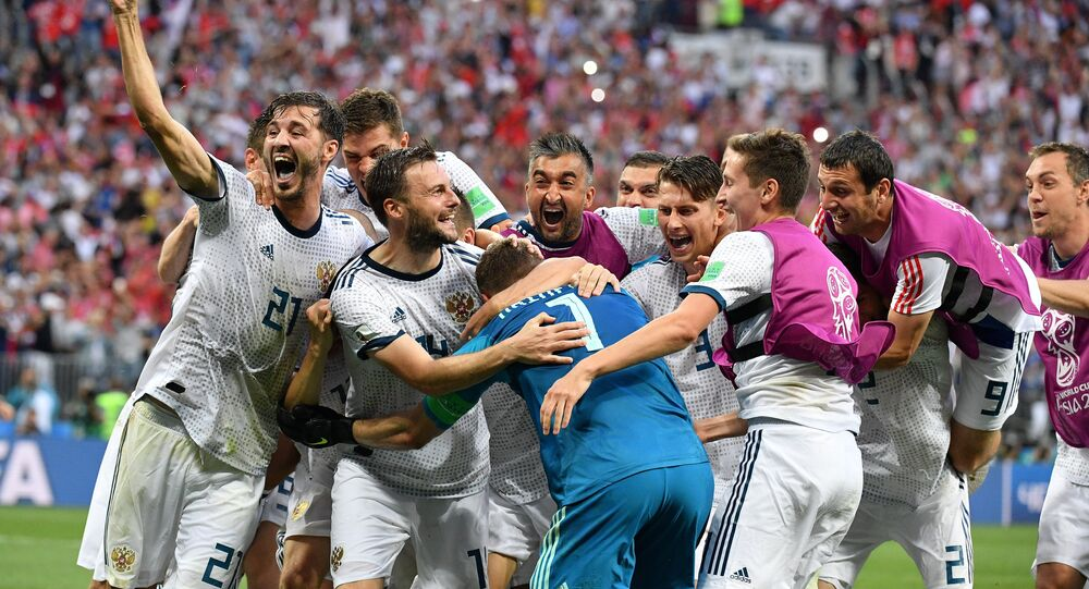 Russia's players celebrate team's victory at the World Cup Round of 16 soccer match between Spain and Russia at the Luzhniki stadium in Moscow, Russia, July 1, 2018.