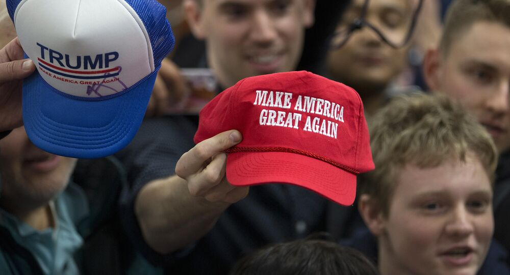 Supporters hold out their hats to get them autographed by Republican presidential candidate Donald Trump at a rally Sunday, Jan. 31, 2016, in Council Bluffs, Iowa