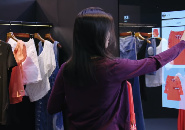 Woman Selects Clothing on Smart Mirror at Alibaba's FashionAI Store in Hong Kong