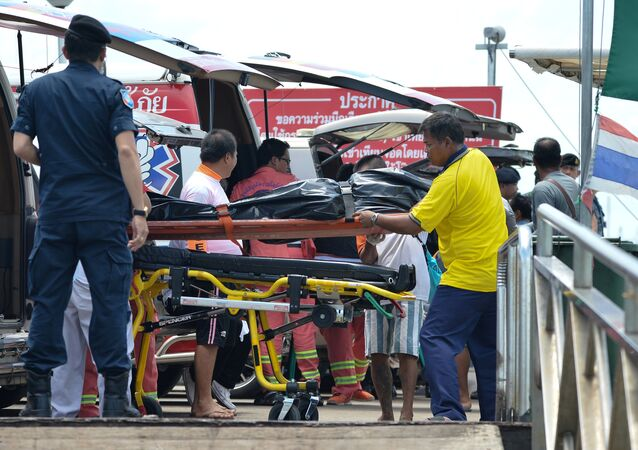 Thai Rescue workers carry the body of a victim on a stretcher, after a boat capsized off the tourist island of Phuket, Thailand, July 6, 2018