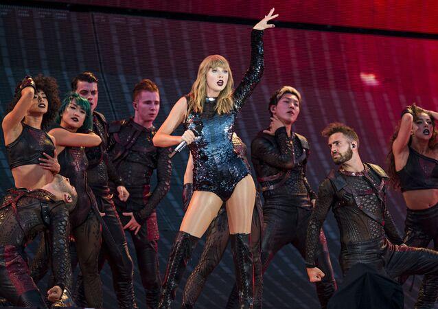 Taylor Swift performing during Taylor Swift's reputation Stadium Tour at Papa John's Cardinal in Louisville.