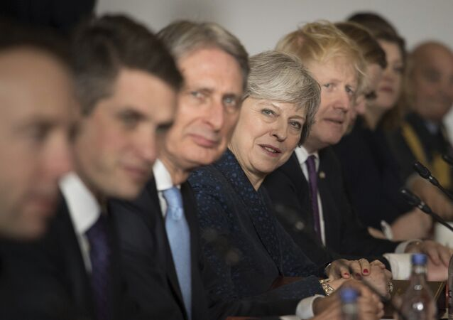 From third left to right, Chancellor Philip Hammond, Prime Minister Theresa May and Foreign Secretary Boris Johnson