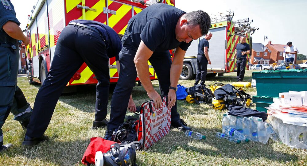 Fire and Rescue Service personel prepare safety equipment at the site of a housing estate on Muggleton Road, after it was confirmed that two people had been poisoned with the nerve-agent Novichok, in Amesbury, Britain, July 6, 2018.