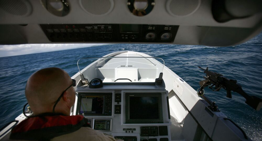 US Custom and Border Patrol Marine Interdiction Agency Supervisor Paul Pope shows the press a prototype boat during a test drive in Ceiba, Puerto Rico, Tuesday, Oct. 13, 2009.