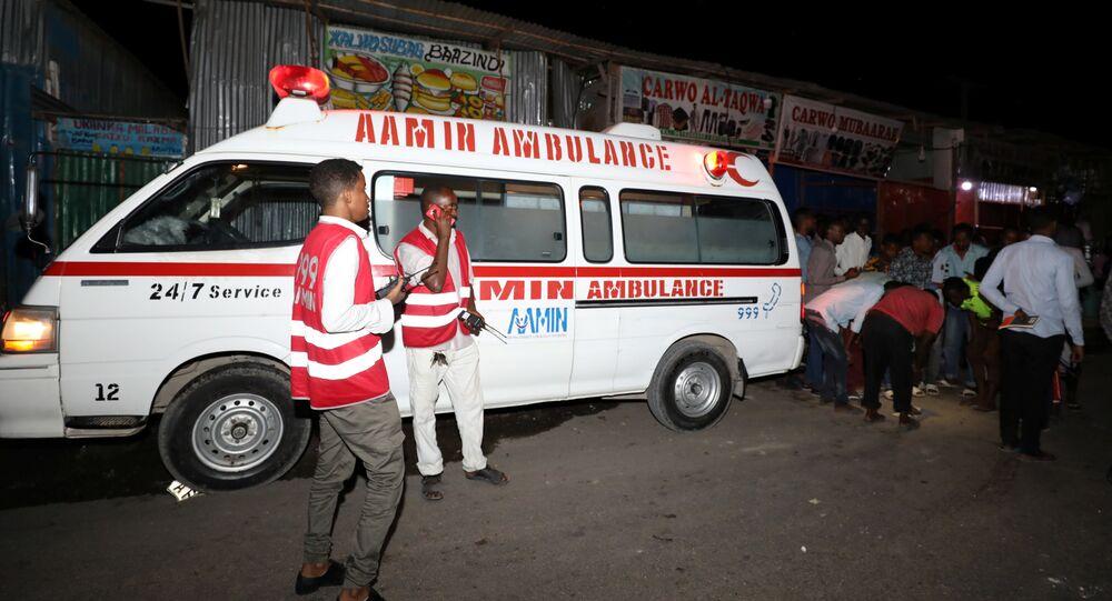 (File) Paramedics stand near an Aamin Ambulance emergency service near the scene of an explosion at the Benadir junction in Mogadishu, Somalia July 2, 2018