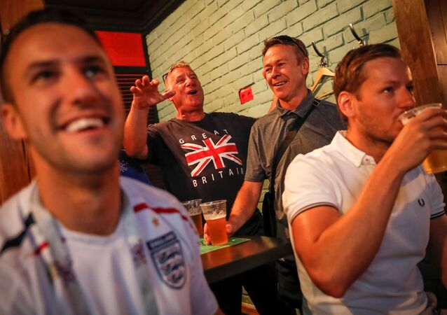 Soccer Football - World Cup - Quarter-Final - Sweden vs England - Samara, Russia - July 6, 2018. Supporters of team England watch the broadcast of the match in a bar