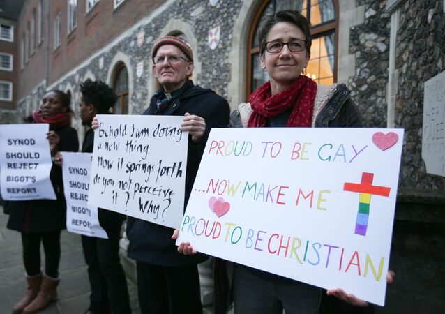Demonstrators hold placards as they protest outside Church House, the venue of the Church of England's General Synod, in London on February 15, 2017