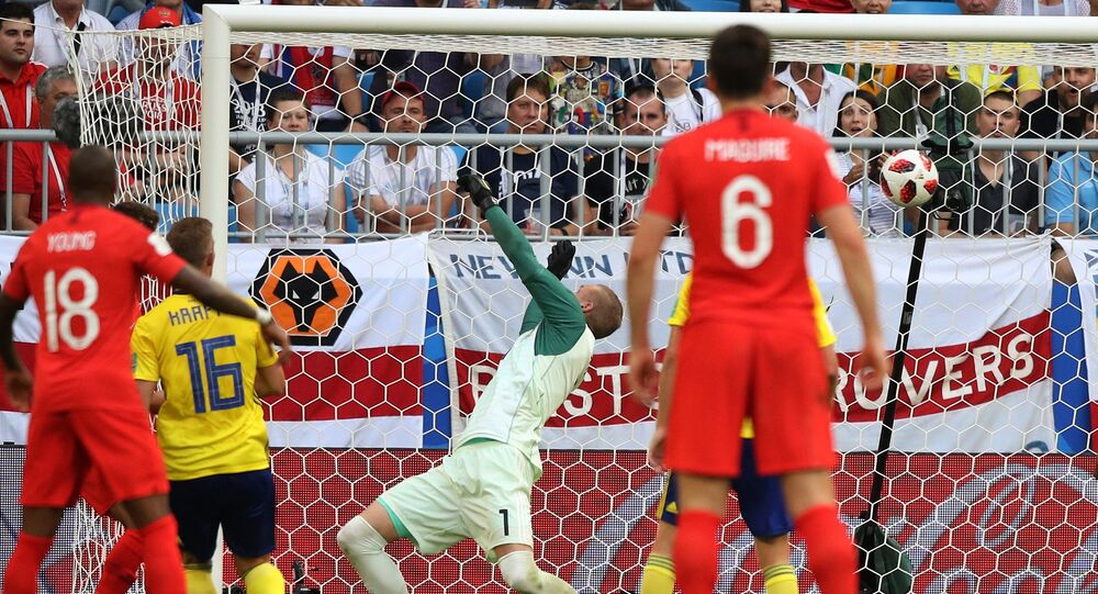 Sweden's goalkeeper Robin Olsen misses a goal during the World Cup quarterfinal soccer match between Sweden and England at the Samara Arena, in Samara, Russia, July 7, 2018