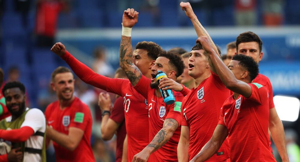 England's players celebrate team's 0-2 victory at the World Cup quarterfinal soccer match between Sweden and England at the Samara Arena, in Samara, Russia, July 7, 2018