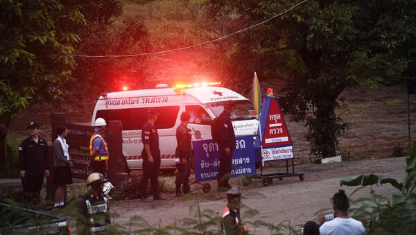 An ambulance leave the Tham Luang cave area after divers evacuated some of the 12 boys and their coach trapped at the cave in Khun Nam Nang Non Forest Park in the Mae Sai district of Chiang Rai province on July 8, 2018 - Sputnik International
