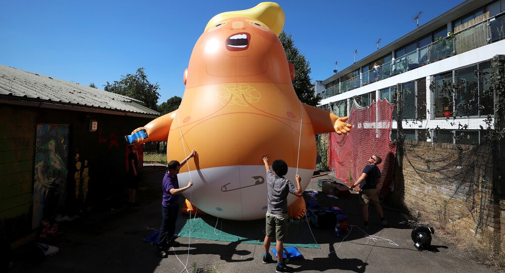 People inflate a helium filled Donald Trump blimp which they hope to deploy during The President of the United States' upcoming visit, in London, Britain, June 26, 2018