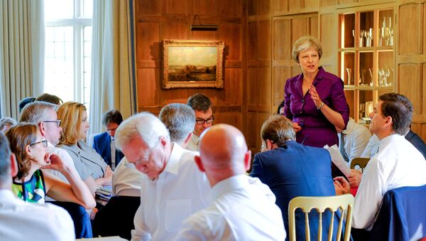 Britain's Prime Minister Theresa May commences a meeting with her cabinet to discuss the government's Brexit plans at Chequers, the Prime Minister's official country residence, near Aylesbury, Britain, July 6, 2018 - Sputnik International