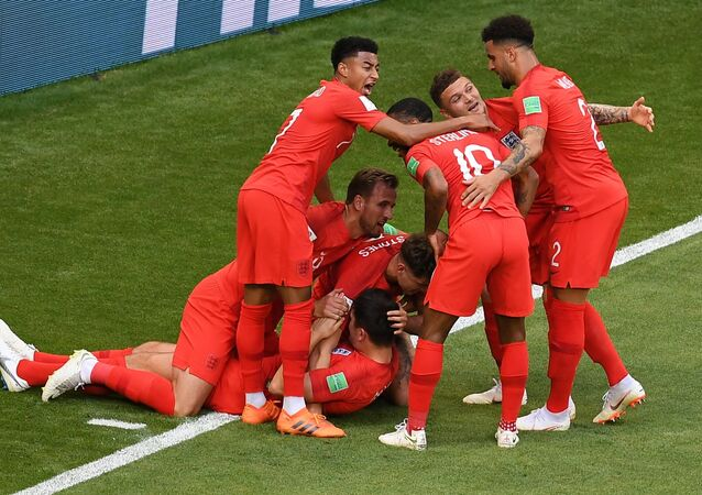 England's players celebrate their team's goal during the World Cup quarterfinal soccer match between Sweden and England, at the Samara Arena, in Samara, Russia, July 7, 2018