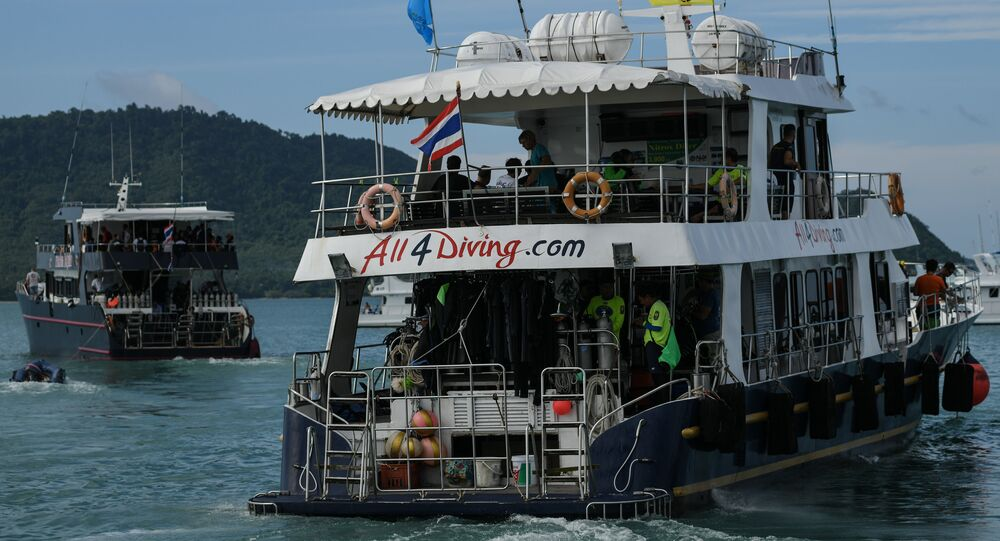 Two boats carrying divers leave Chalong pier in Phuket on July 7, 2018, as rescue operations continue for missing tourists following a boat accident on July 5