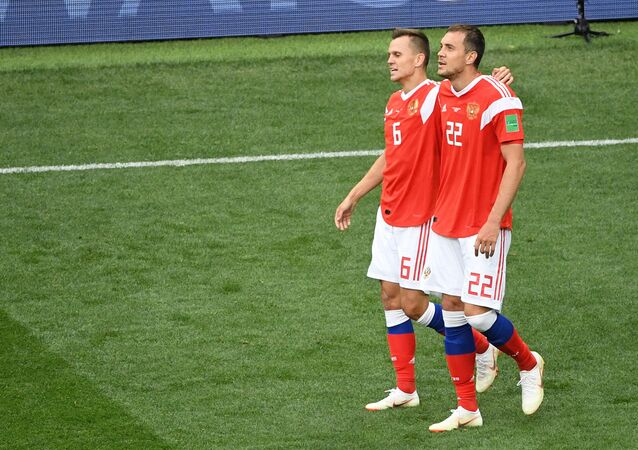 Russia's Denis Cheryshev and Artyom Dzyuba walk after team's 0-5 victory over Saudi Arabia at the World Cup Group A soccer match at the Luzhniki stadium in Moscow, Russia, June 14, 2018