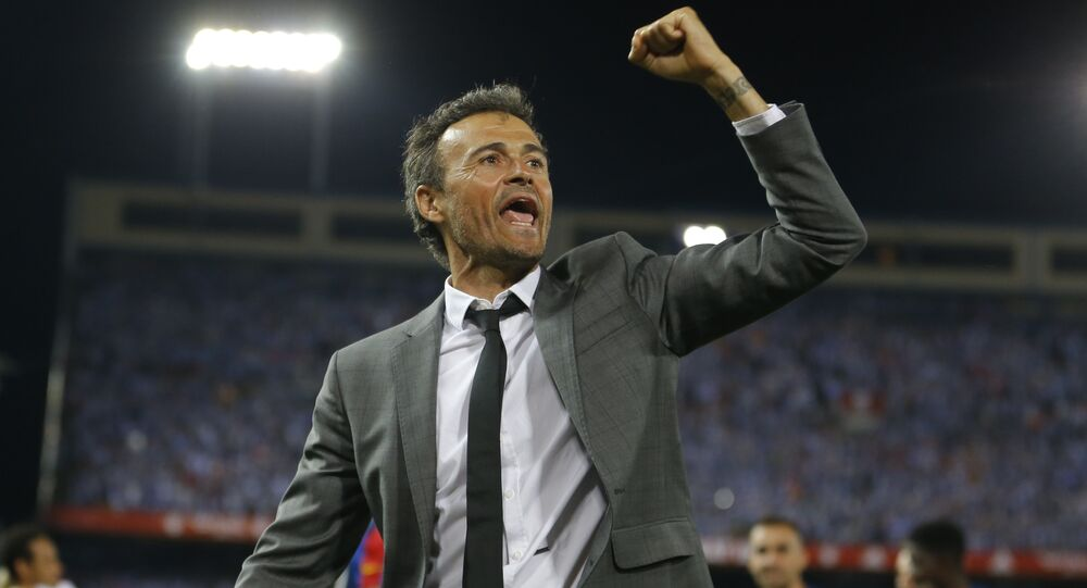 (File) Barcelona's head coach Luis Enrique celebrates after the Copa del Rey final soccer match between Barcelona and Alaves at the Vicente Calderon stadium in Madrid, Spain, Saturday, May 27, 2017