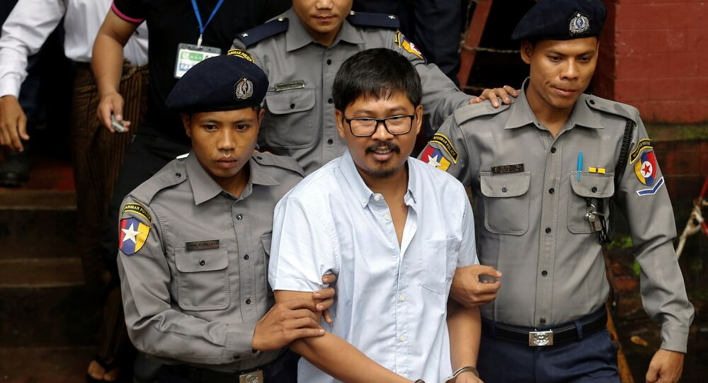 Detained Reuters journalist Wa Lone is escorted by police while leaving Insein court in Yangon, Myanmar July 9, 2018