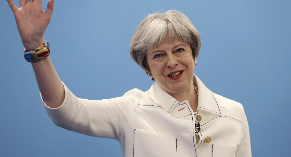 Britain's Prime Minister Theresa May, gestures during the Conservative Party's Spring Forum in central London, Saturday, March 17, 2018.