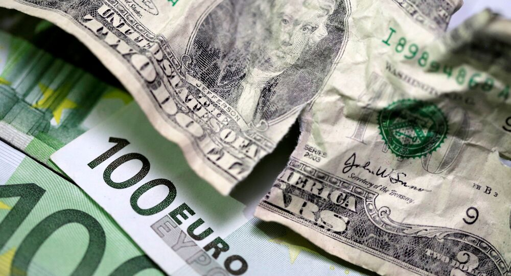 U.S. dollar and Euro banknotes are seen in this picture illustration taken May 3, 2018